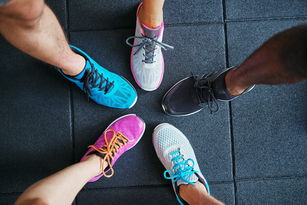 peoples wearing different colors shoes