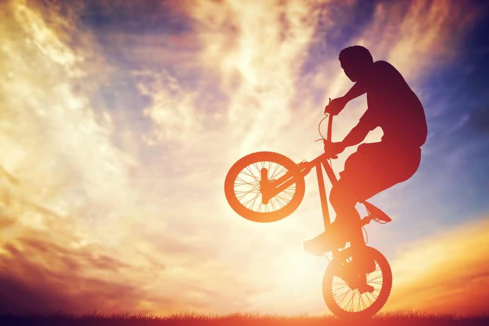 man performing on bmx bike