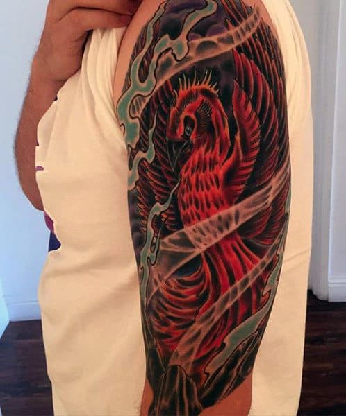 Red Fire Phoenix Ink Tattoo On Man's Arm