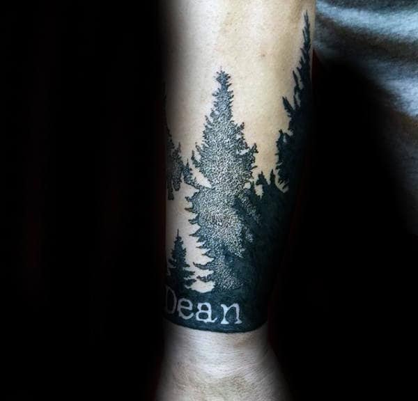 Pine Tree Forest Name Wrist Tattoo For Men With Negative Space Design