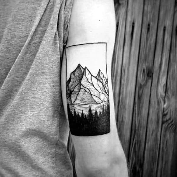 Pine Trees With Mountain Guys Back Of Arm Tattoo