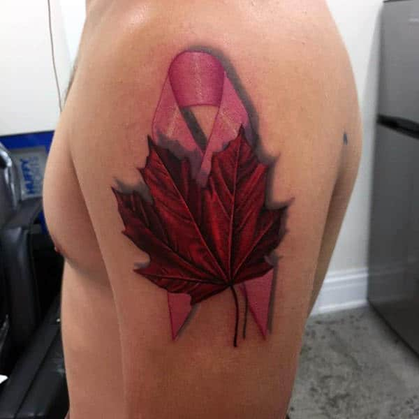 Pink Ribbon With Red Maple Leaf Guys Upper Arm Tattoo