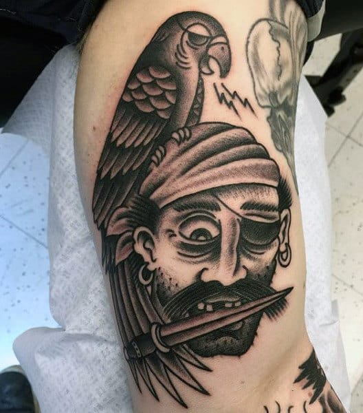 Pirate Themed Tattoo Sleeve On Man's Bicep