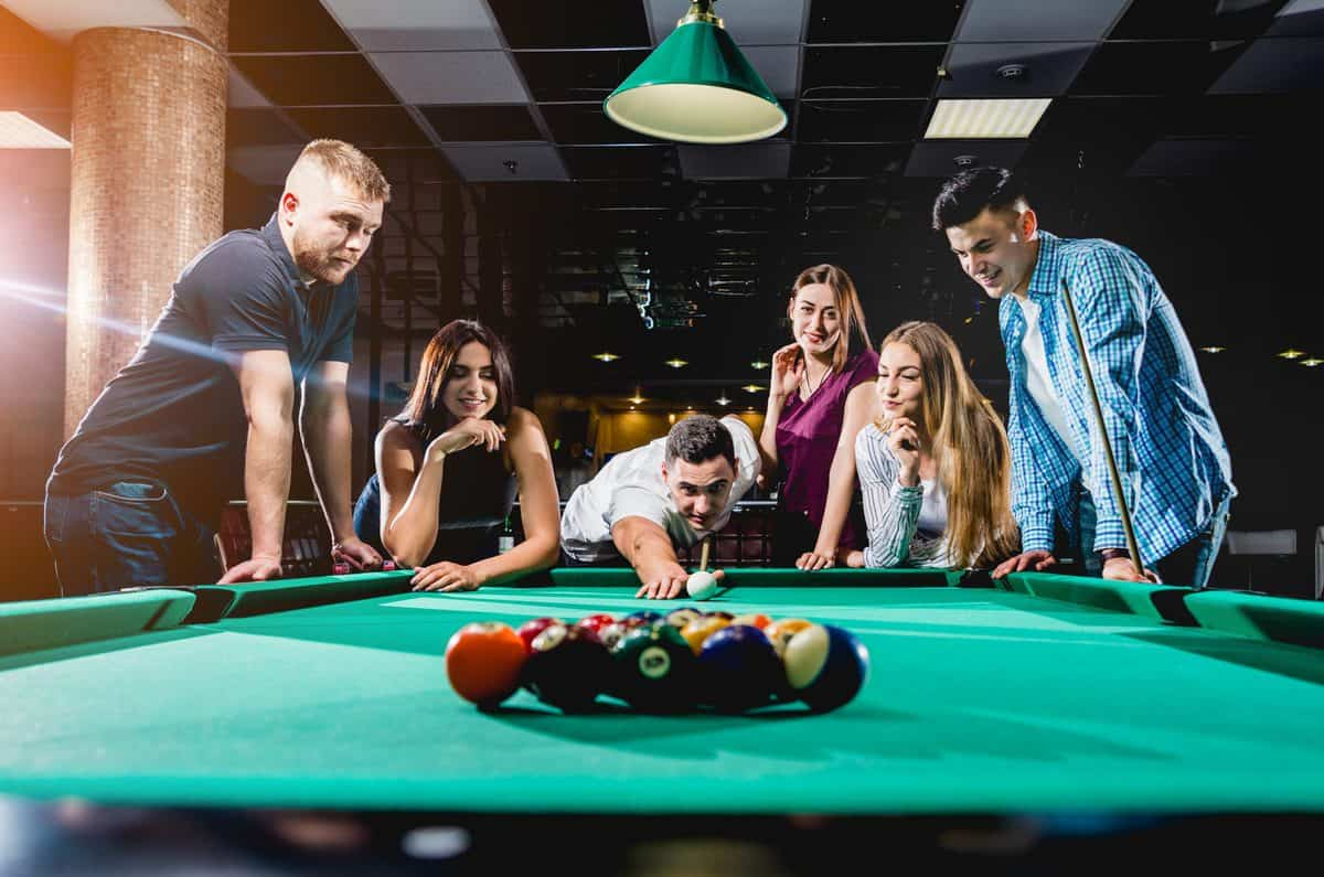 Group,Of,Young,Cheerful,Friends,Playing,Billiards.,Funny,Time,After