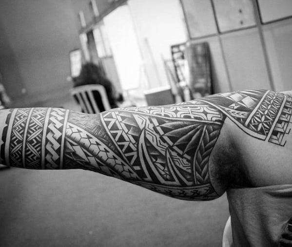 Polynesian Sleeve Male Unique Tattoo Design On Arm