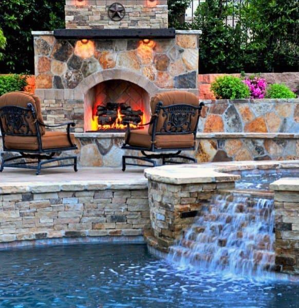 Pool Backyard Waterfalls With Fireplace Patio