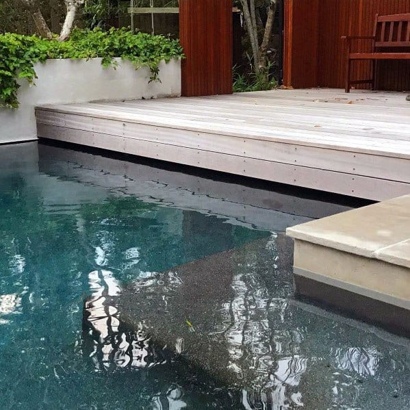 Pool With Floating Wood Deck Ideas