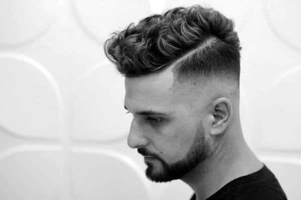 Popular Curly Fade Haircut For Men With Hard Part Shaved In Line