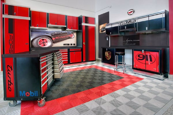 Porsche Themed Garage With Work Bench And Storage Cabinets