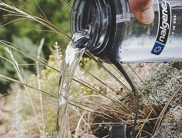 Pouring Out Crystal Clear Clean Water Katadyn Gravity Befree Water Filtration System