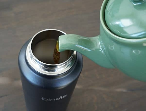 Pouring Strawberry Tea Into Top Of Stainelsss Steel Bindle Bottle