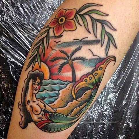 Pretty Mermaid Under Palm Tree Tattoo For Guys On Legs