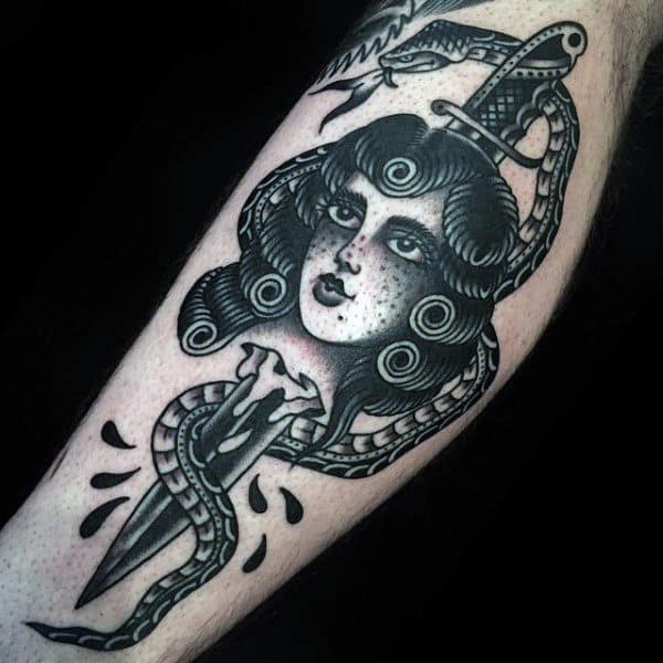 Pretty Woman With Broken Knife And Snake Tattoo On Mens Forearm