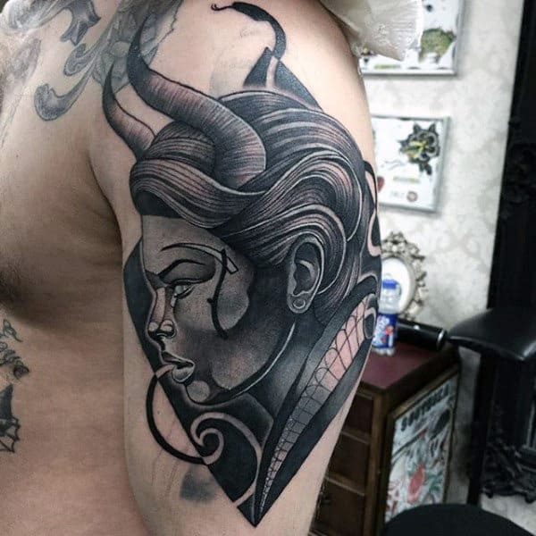 Profile View Of Horned Man Male Arms Tattos