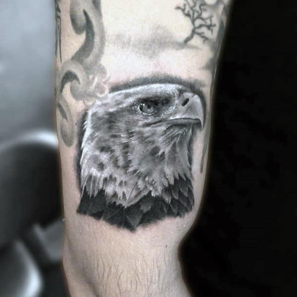 Proud American Eagle Hawk Head Tattoo On Upper Arm On Man