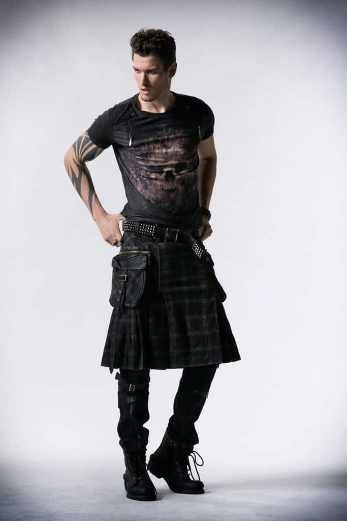 Man in long plaid black kilt