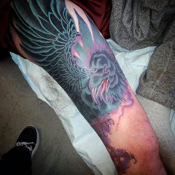 Purple And Grey Shaded Raven Tattoo Mans Arms