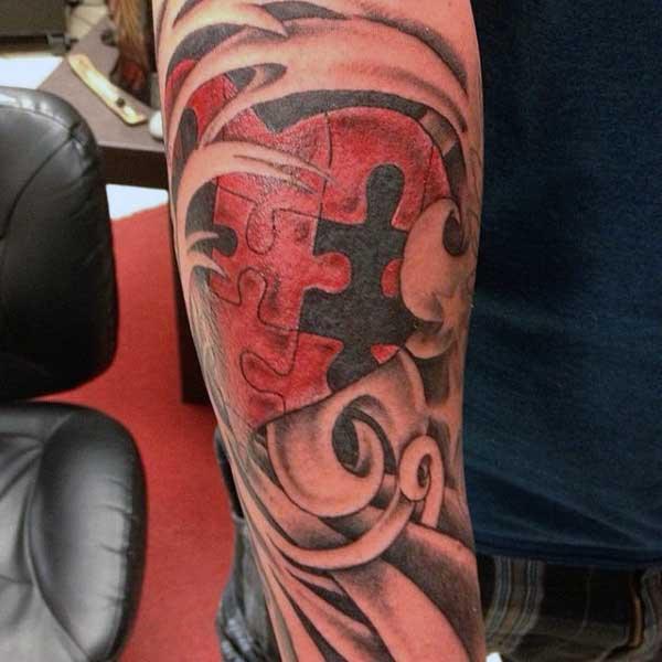 Puzzle Tattoo Guy Forearm Heart