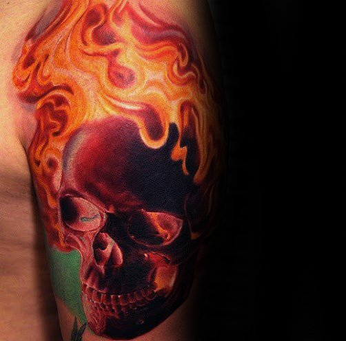 Quarter Sleeve Male Tattoo With Flaming Skull Design