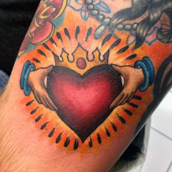 Radiant Irish Claddagh Tattoo Designs On Arm