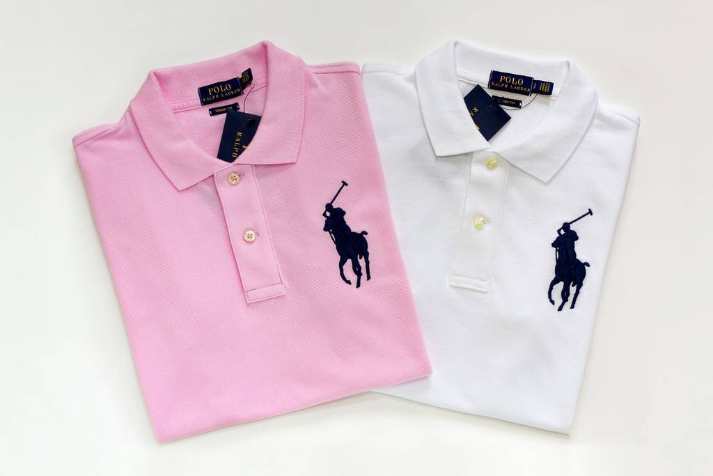 A pink Ralph Lauren polo and a white Ralph Lauren polo on a white background