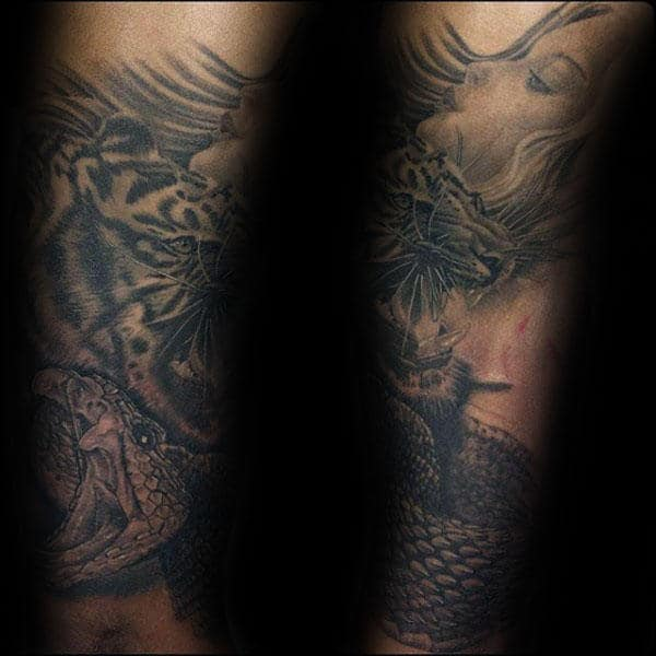 Rattlesnake Tattoo On Mans Forearms