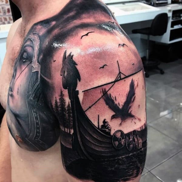 Raven Flying Above A Boat Tattoo Male Shoulders