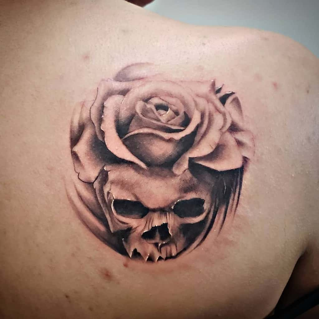 realism-black-grey-skull-rose-tattoo-bodyartistsd