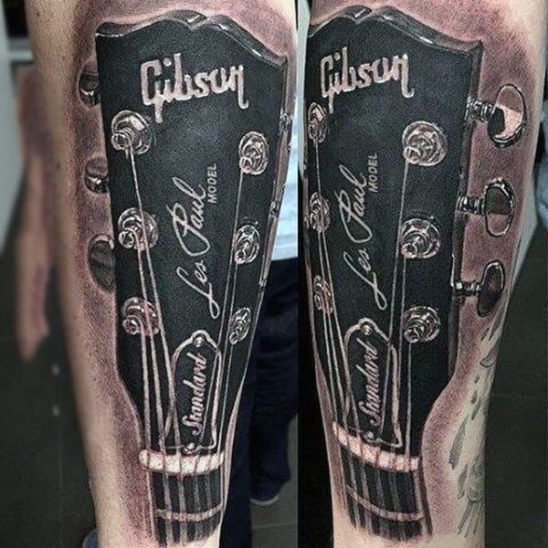 Realism Tattoo Of Musical Instrument Mens Lower Legs