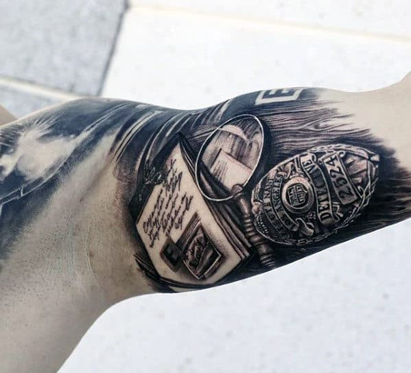 Realistic 3d Police Detective Badge With Papers And Magnifying Glass Mens Quarter Sleeve Tattoo