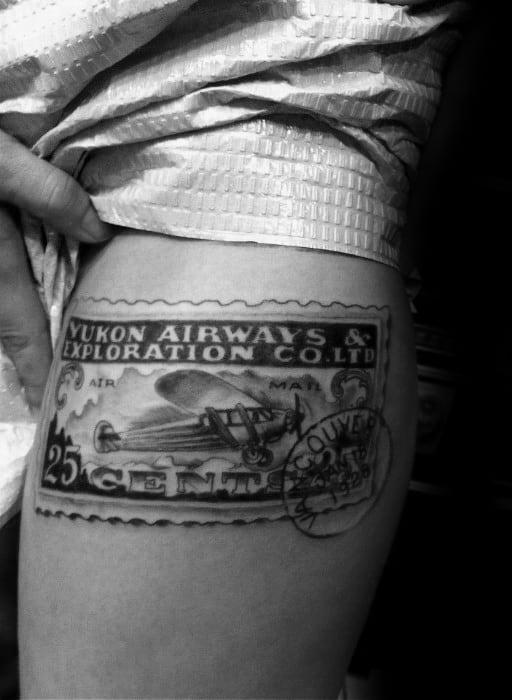 Realistic Arm Male Postage Stamp Tattoo Design Inspiration