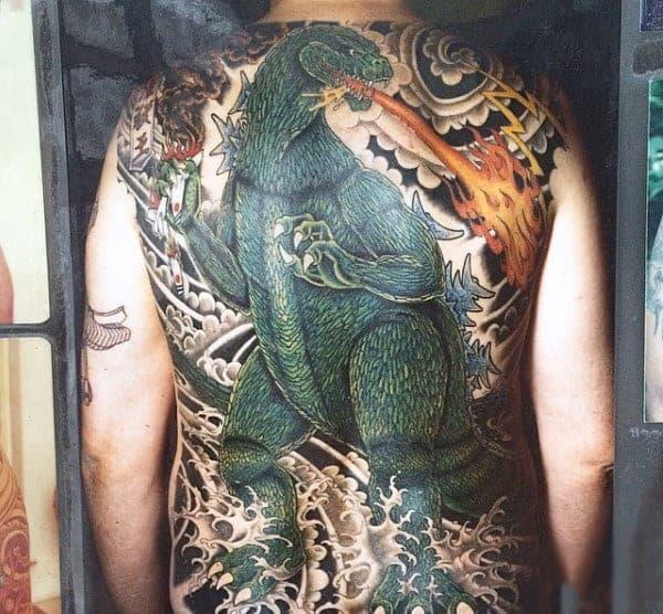 realistic-backpiece-of-godzilla-with-fire-lightning-water-tattoo-on-guy