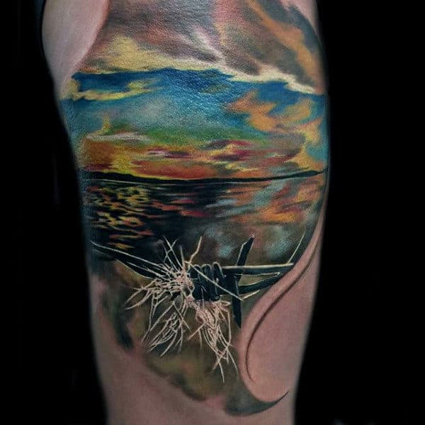 Realistic Barbed Wire Ocean Tattoo On Mans Arm