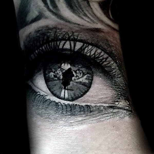 Realistic Eye With Motorcycle Rider Design Tattoo For Men