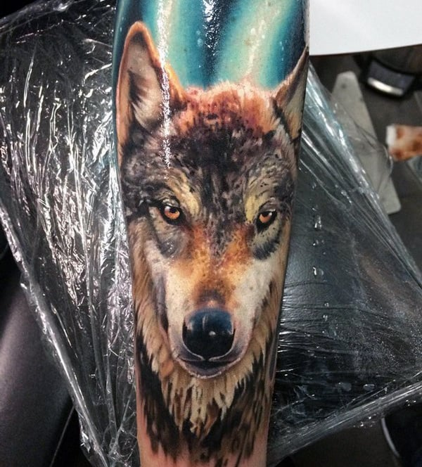 Realistic Forearm Wolf Sleeve Tattoos On Man