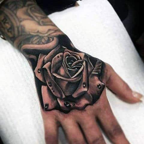 Realistic Grey Rose And Dewdrops Tattoo Guys Hand