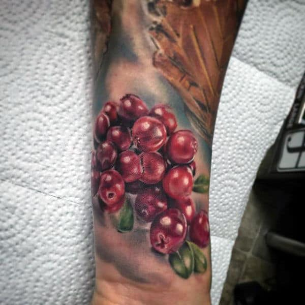 Realistic Male Forearms Glossy Grapes Tattoo