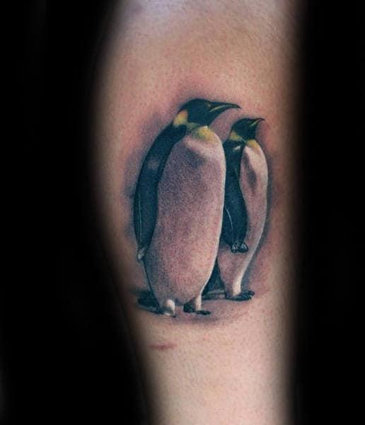 Realistic Male Penguins Tattoo Design On Leg