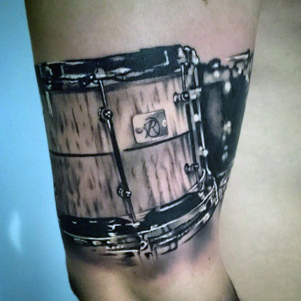 Realistic Male Tattoos Of Drums On Arm