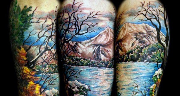 Realistic Men's Arm Tattoo With Mountain On Arms