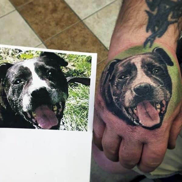 Realistic Mens Hand Tattoo Of Dog