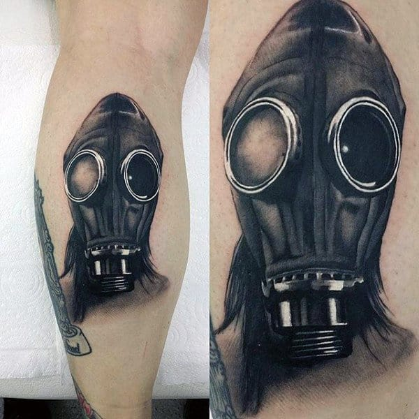 Realistic Polish Mua Gas Mask Tattoo On Mans Inner Leg Calf