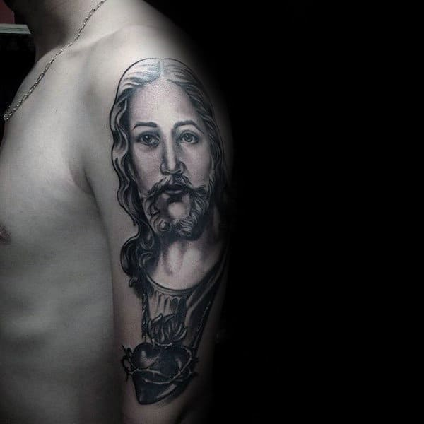 Realistic Sacred Heart With Portrait Of Jesus Arm Tattoo On Man