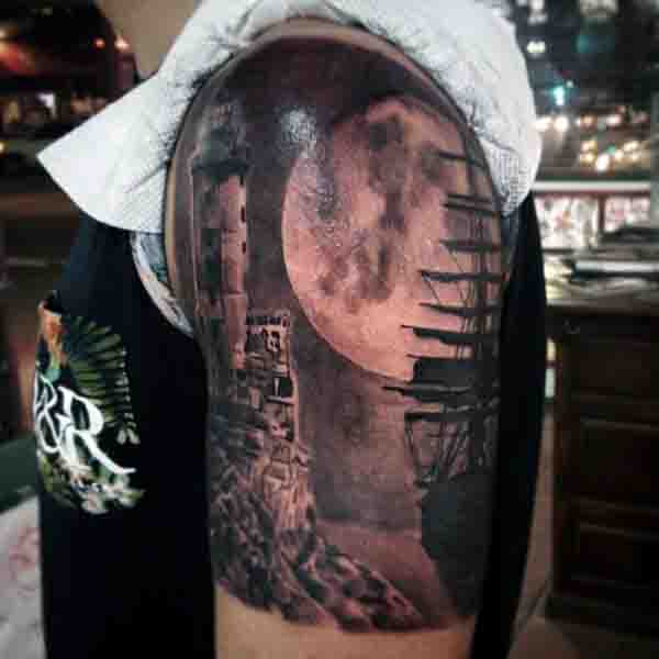 Realistic Sailing Ship Moon Tattoo With Lighthouse On Upper Arm