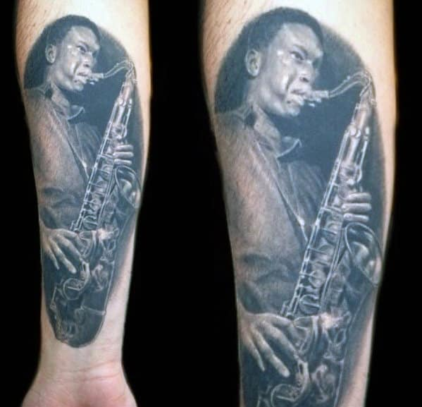 Realistic Shaded Black And Grey Portrait Saxophone Player Mens Inner Forearm Tattoo