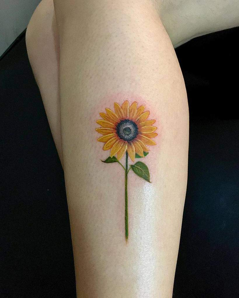 Realistic sunflower female tattoo