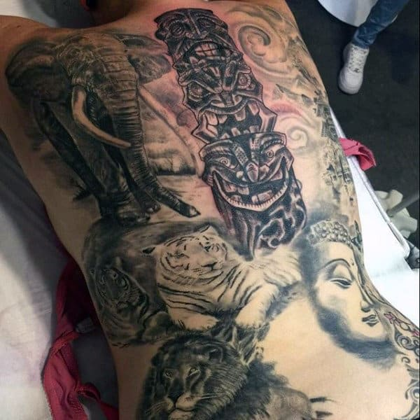 Realistic Totem Pole Surrounded By Animals Back Tattoo On Gentleman