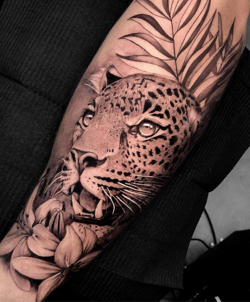 realistic-wild-sleeve-jaguar-tattoo-maria.alvarez.tattoo