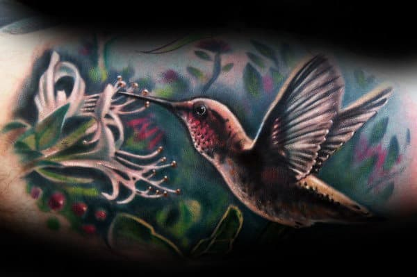 Realsitic Hummingbird With White Flower Watercolor Background Tattoo On Mans Inner Arm