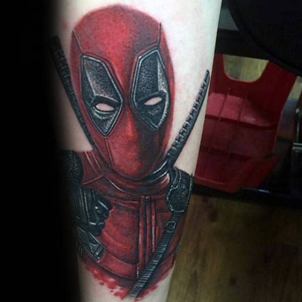 Red And Black Ink Deadpool Male Forearm Tattoos